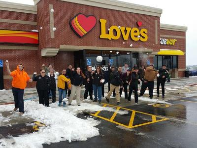 Snowfall at Love's Travel Stops opening in Valley, Nebraska