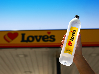 love's premium water bottle next to loves canopy