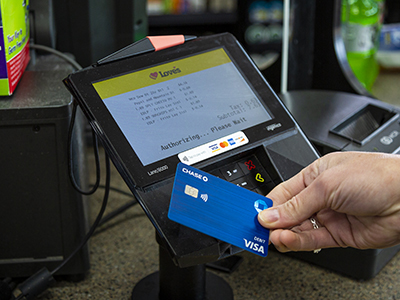 person using contactless payment option on in-store key pad at Love's Travel Stops