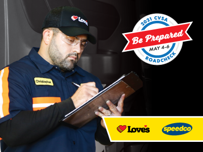 Love's Truck care employee reviewing paperwork and CVSA Roadcheck logo