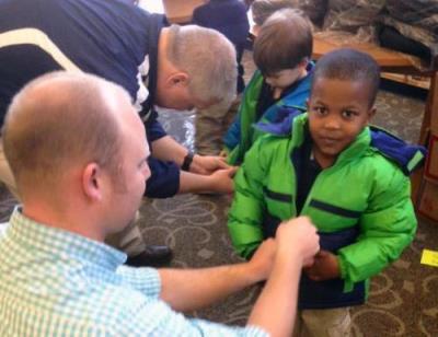 Love's employee helps kid with coat