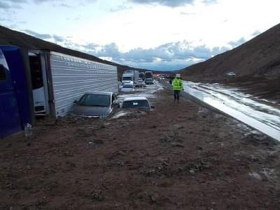 cars and trucks stuck in mudslide on highway