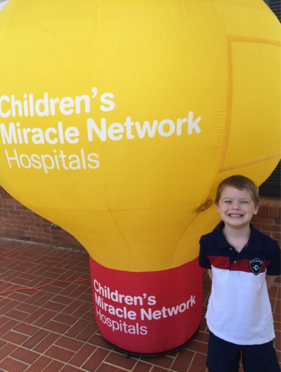 Miracle child Brayden with CMNH balloon