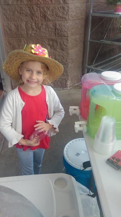 Love's family member sells lemonade for CMNH
