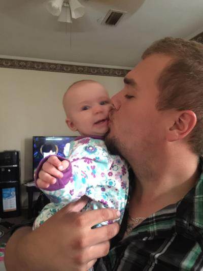 Dad kissing daughter