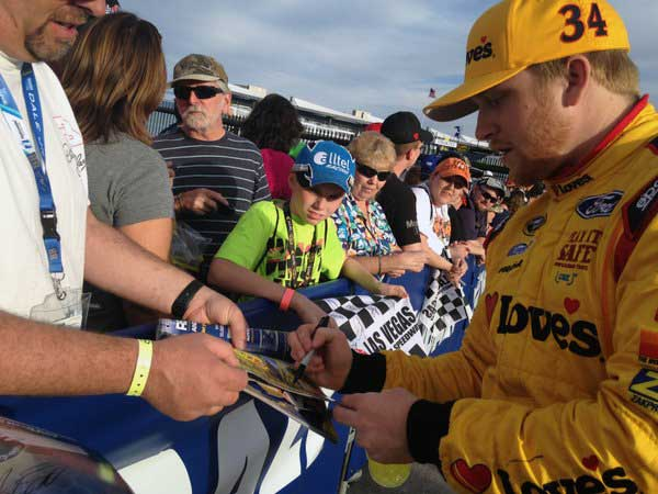 Chris Buescher signing autographs in Texas
