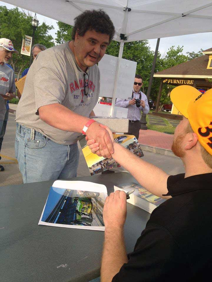 Chris Buescher signing autographs