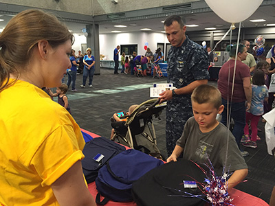 military family picking out backpacks