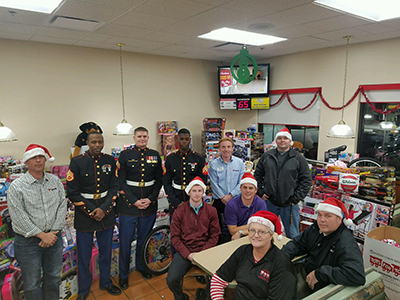 marines and loves employees with toys for tots donation