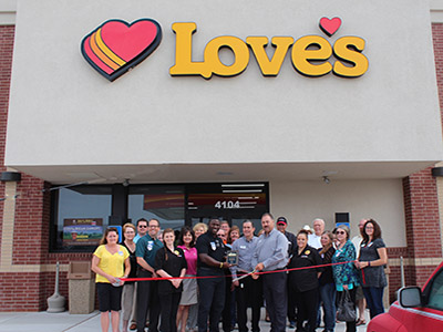 ribbon cutting for Enid Love's location
