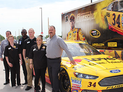 Love's employees with No. 34 Love's Ford Fusion showcar