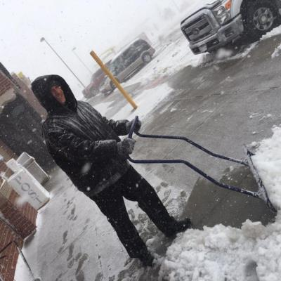 Bennett Colorado Love's employees shovels snow
