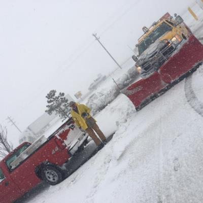 Love's service truck plowing parking lot