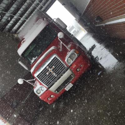 tractor-trailer at Love's in snow storm