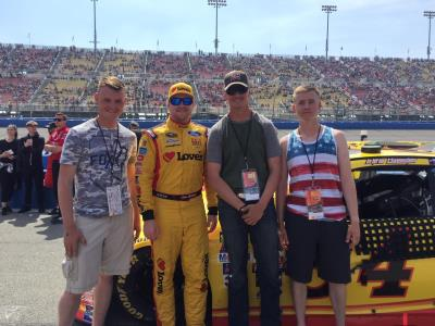 Chris Buescher with military veterans at Fontana