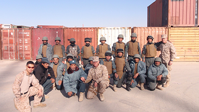 us marine corps with afghan police