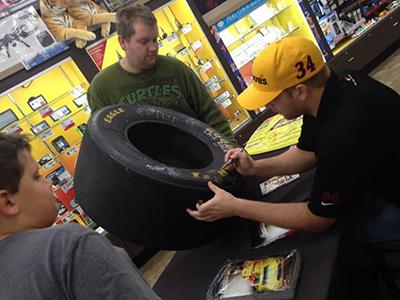 buescher signs fan tire