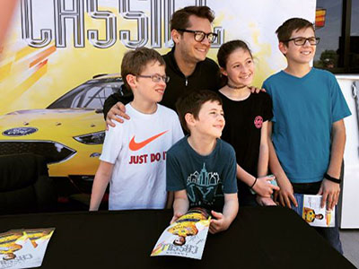 group of young nascar fans with cassill