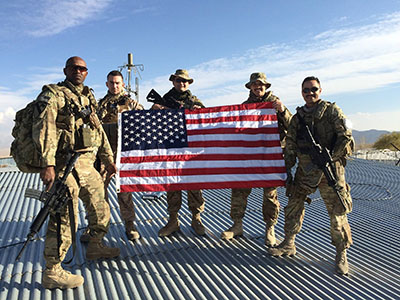 air force officers with american flag