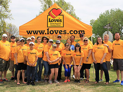 loves travel stops volunteers at redbud water stop