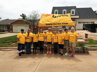 volunteers with Love's at Redbud Classic water stop