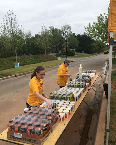love's volunteer fills cups for redbud