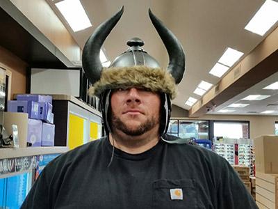 man wearing viking helmet at loves