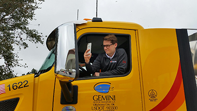 landon cassill takes selfie with big rig