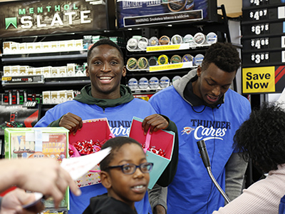 thunder players pass out candy at Love's