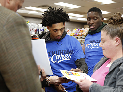 cameron payne signs autograph at loves
