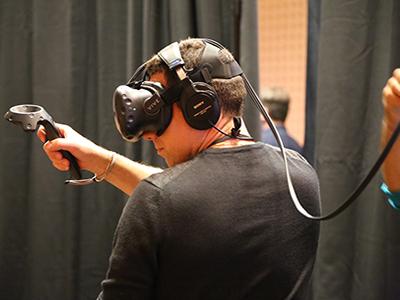 loves manager enjoys VR game in OKC