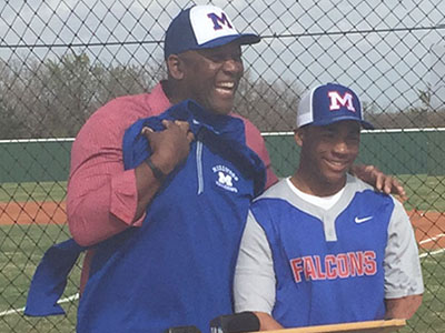 Joe Carter with Millwood High School baseball player
