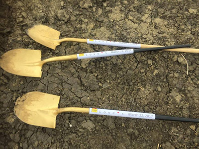 golden shovels for Love's groundbreaking ceremony