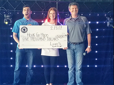 Hogs for Hope check presentation with Love's Travel Stops