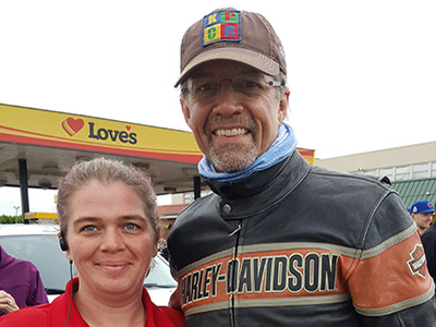 kyle petty smiles with loves employee