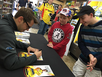 landon cassill with young race fans