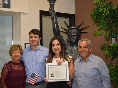 new us citizen smiles with Colombian parents