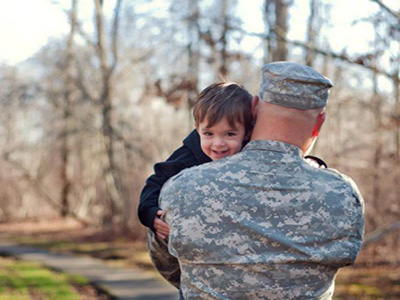 military father with young son