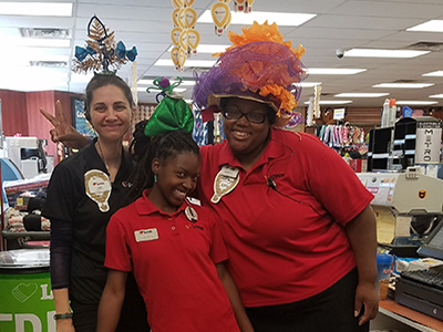 team members with silly hats for fundraiser