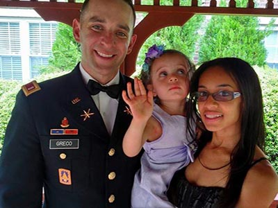us army officer in blues with wife and daughter