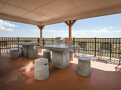 Pecos outdoor area with seating and grills