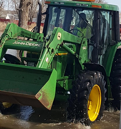 tractor in midwest floodwaters