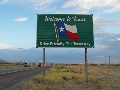 welcome to texas sign on the highway